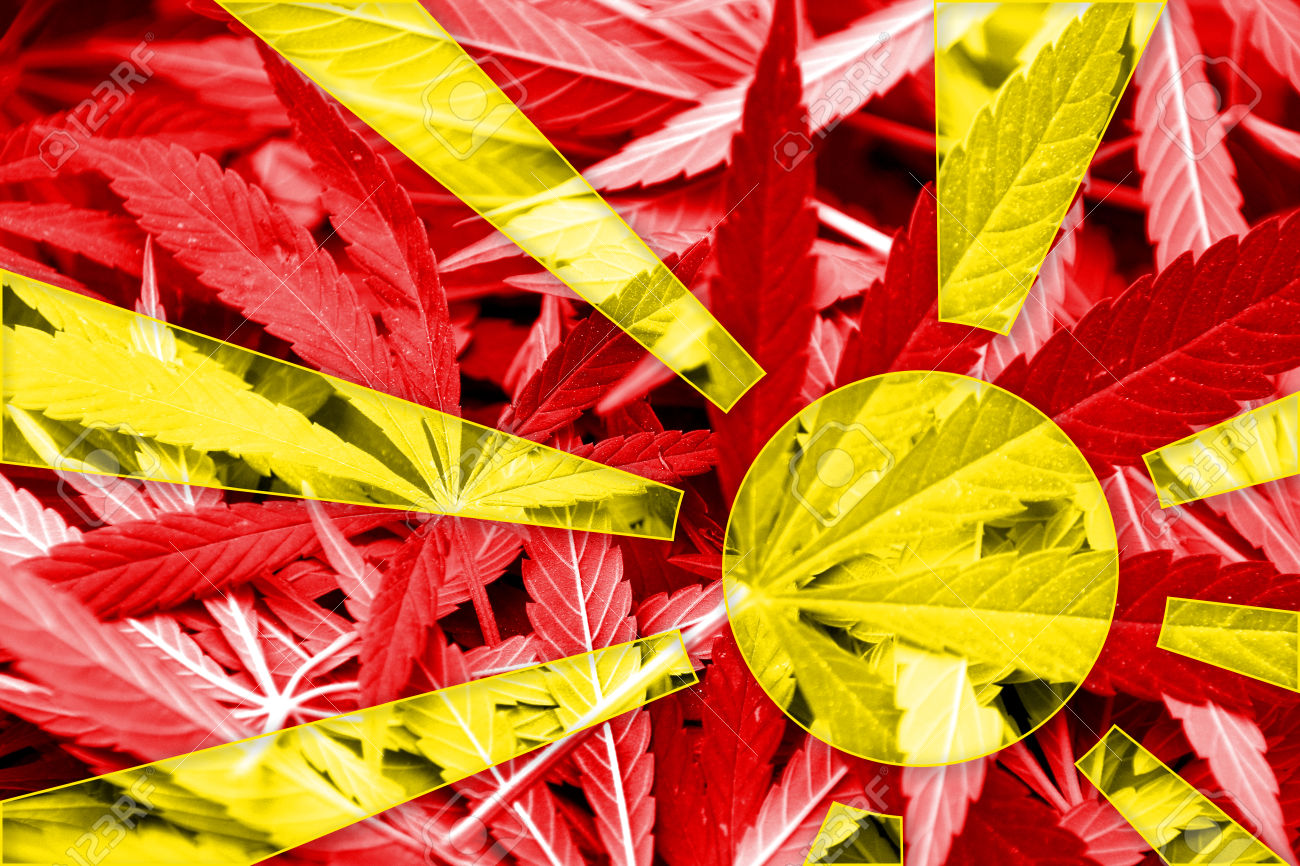Macedonia Flag on cannabis background. Drug policy. Legalization of marijuana